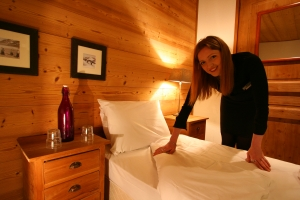 Chalet host doing her daily service of bedrooms at Chalet Belvedere