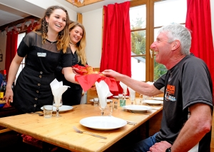 Chalet hosts serving breakfast at Chalet Chardons